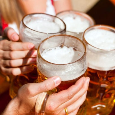 People who toast with a beer mug