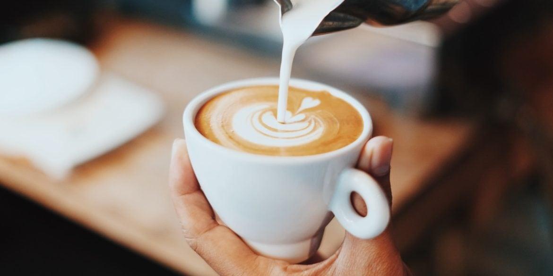 A barista is doing Latte Art